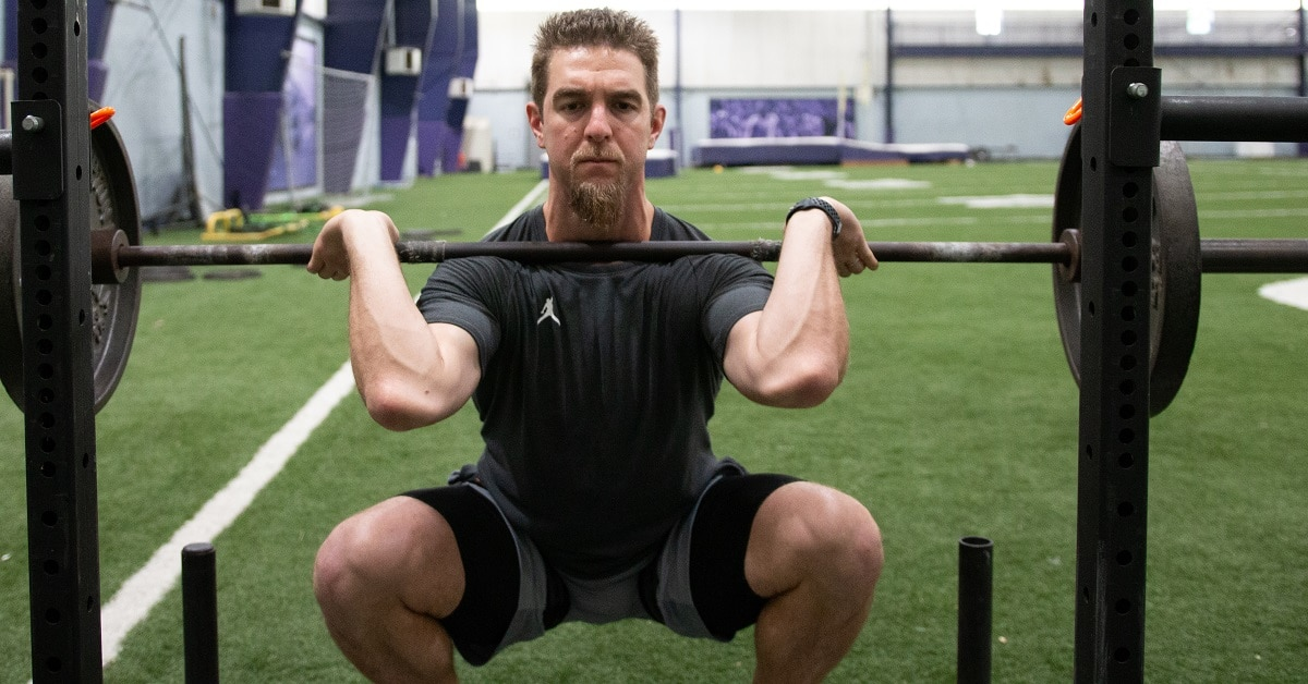 Squatting with BFR straps